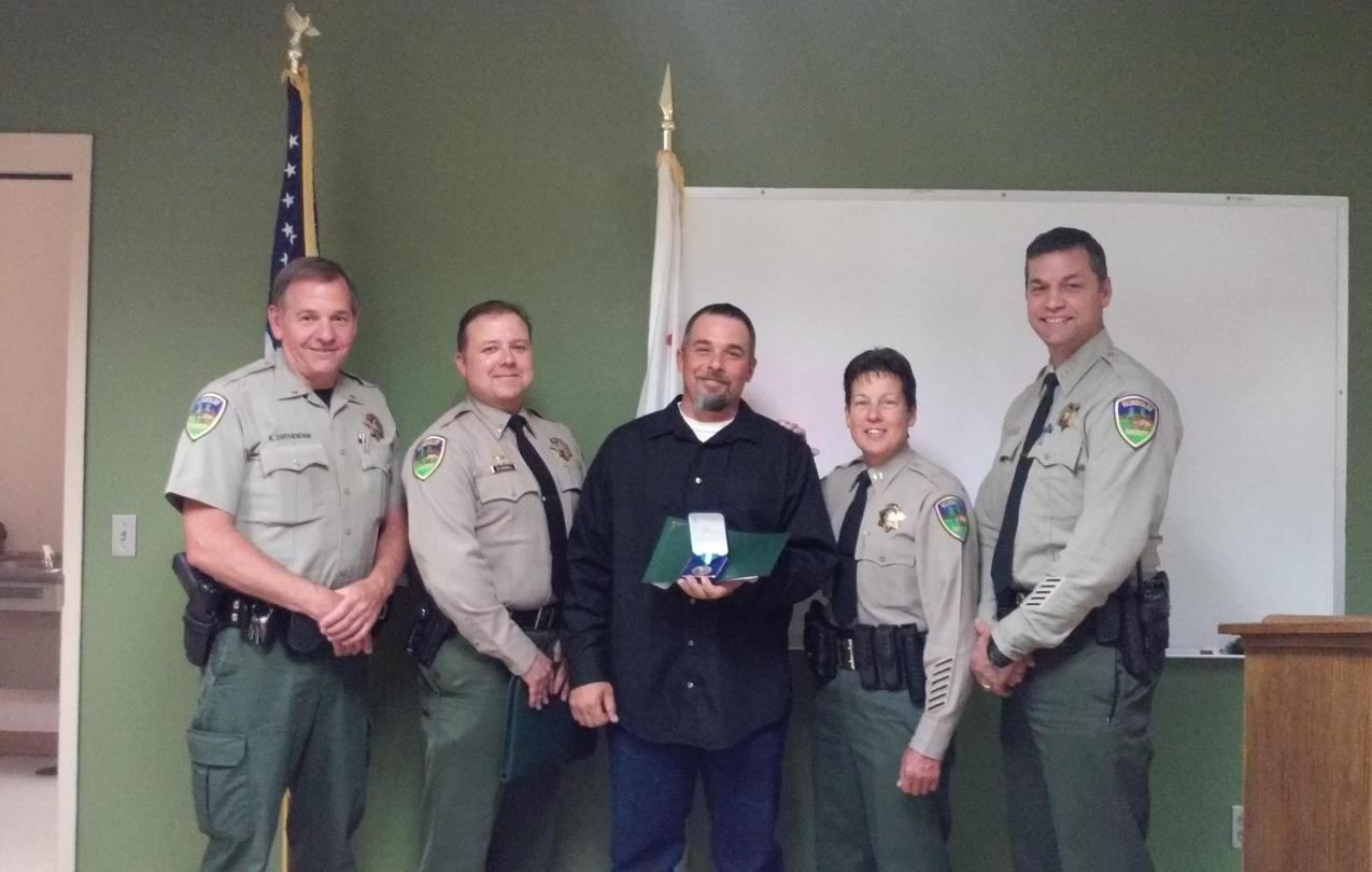 From left to right: Lt. Ken Swithenbank, Lt. Bryan Quenell, John Marciel, Captain Kym Thompson and Sheriff William Honsal.