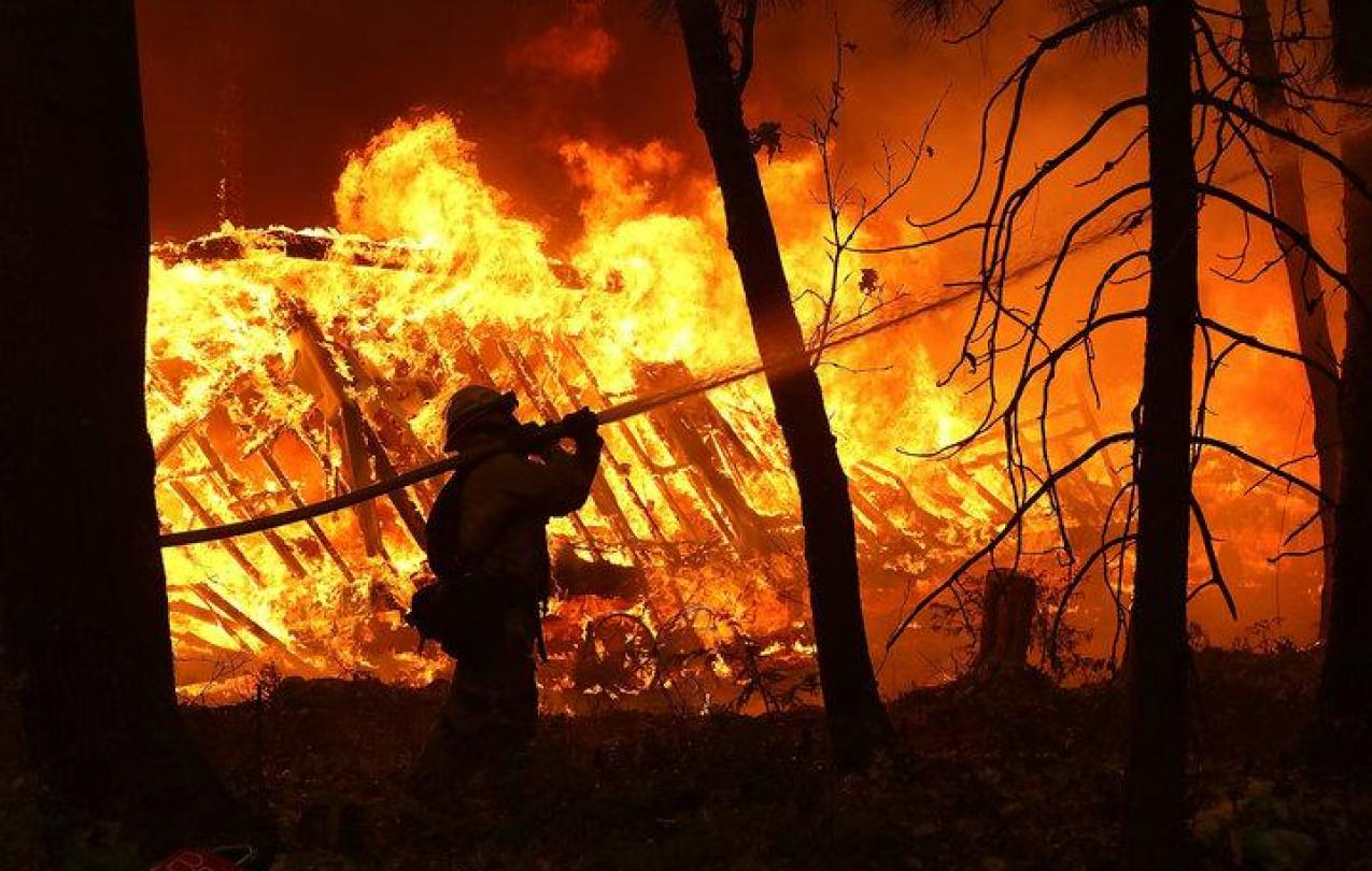 Firefighters work in dangerous conditions to fight the fast-moving fires in northern and southern California. (Justin Sullivan/Getty Images)