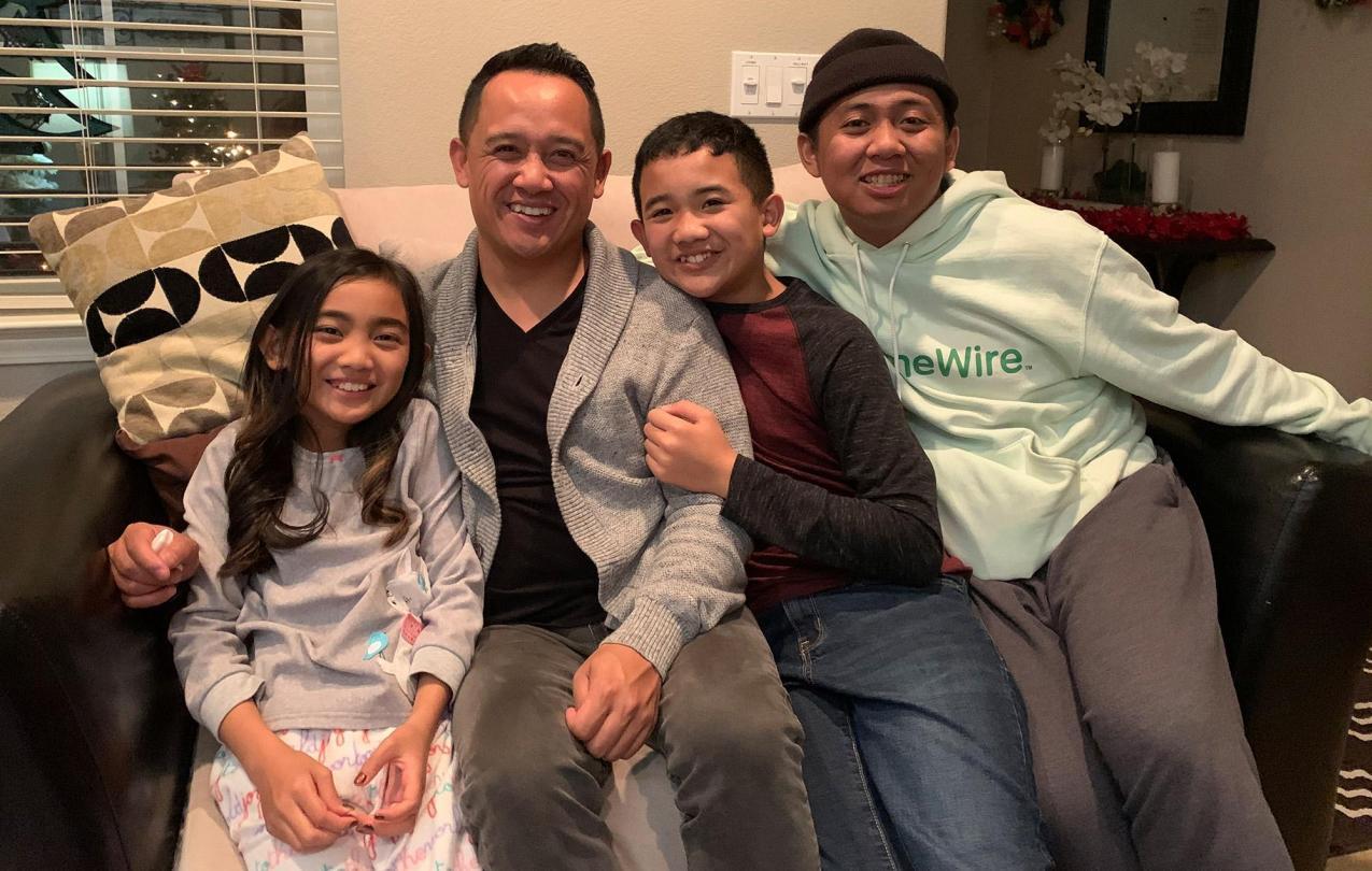 Paul Megia with three of his kids (Photo credit: Courtesy of Luci Megia)