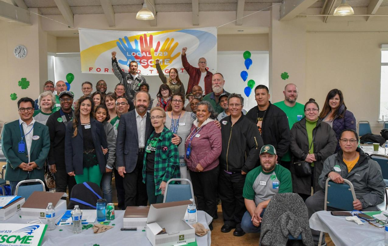 California State Sen. Jerry Hill takes a photo with AFSCME Local 829 members at their rally in Belmont