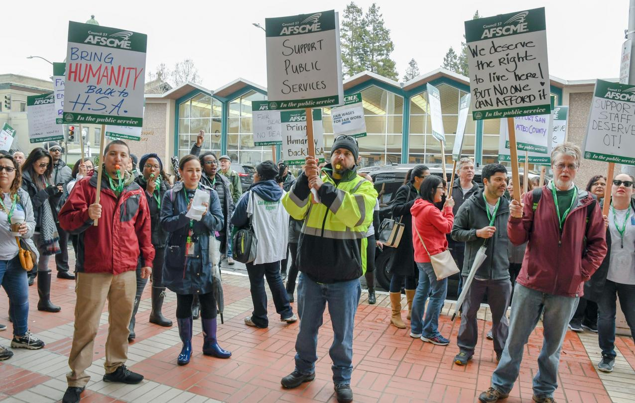 AFSCME Local 829 members hold a strike outside of the San Mateo County Government Center in Redwood City.