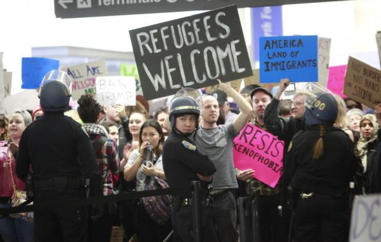 Protesters at SFO condemning President Trump's executive order banning Muslims. (Mercury News)