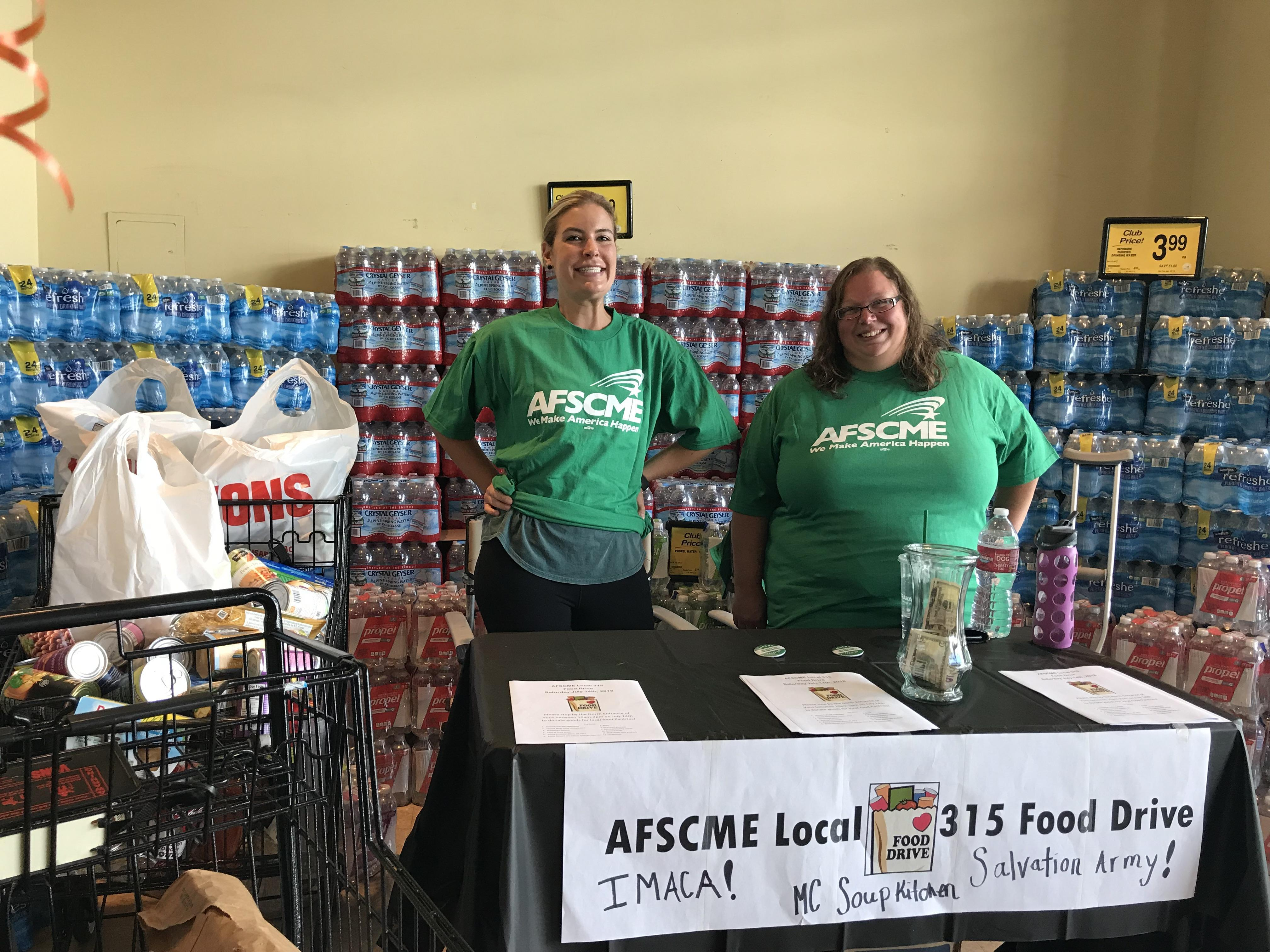 AFSCME Local 315 members Eryn Clark and Laura Bourelle work the booth at the local's food drive in Bishop.